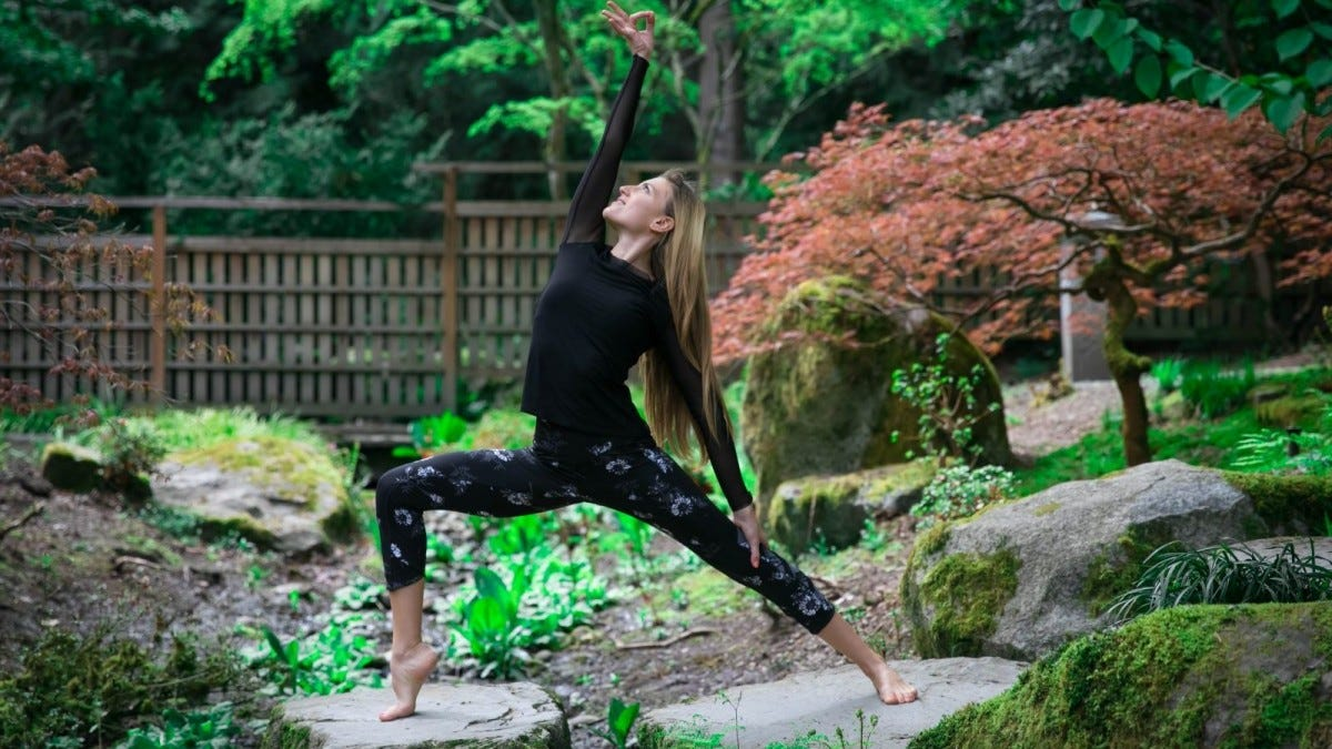 Woman doing reverse warrior yoga pose
