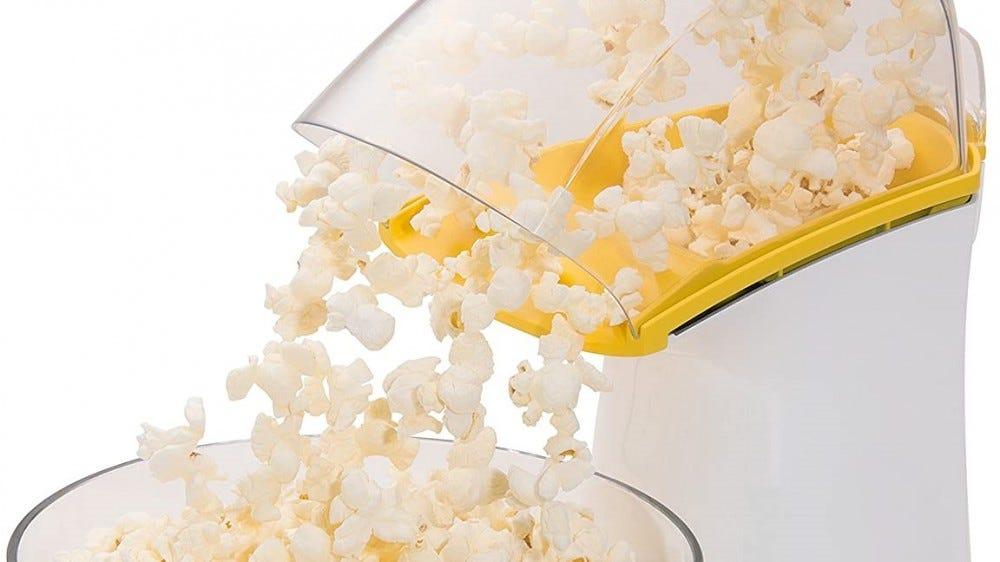 The PopLite air popper popping popcorn.