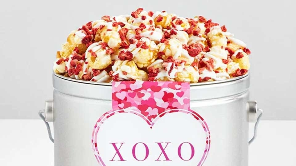 "A bucket of ""champagne"" sweet popcorn from The Popcorn Factory."