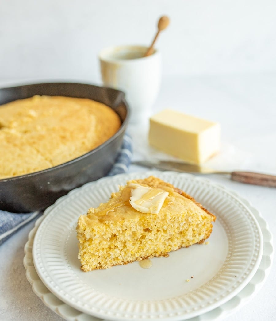 Cornbread on a plate with butter on top