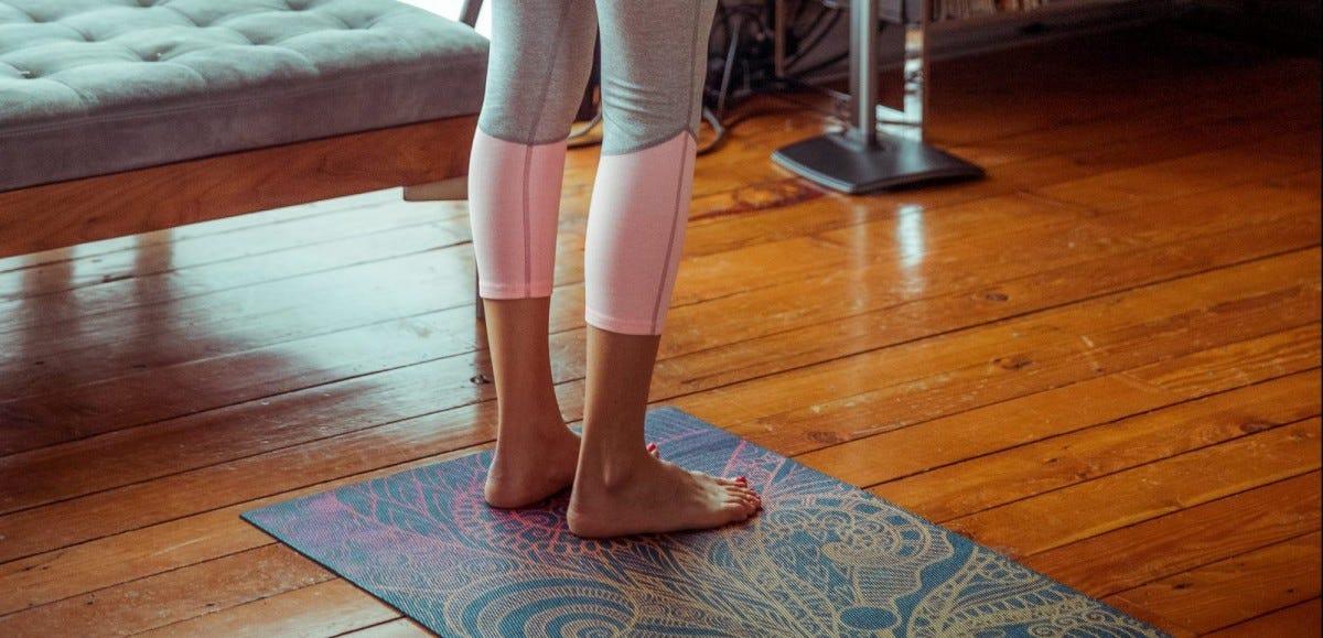 Woman standing on yoga mat