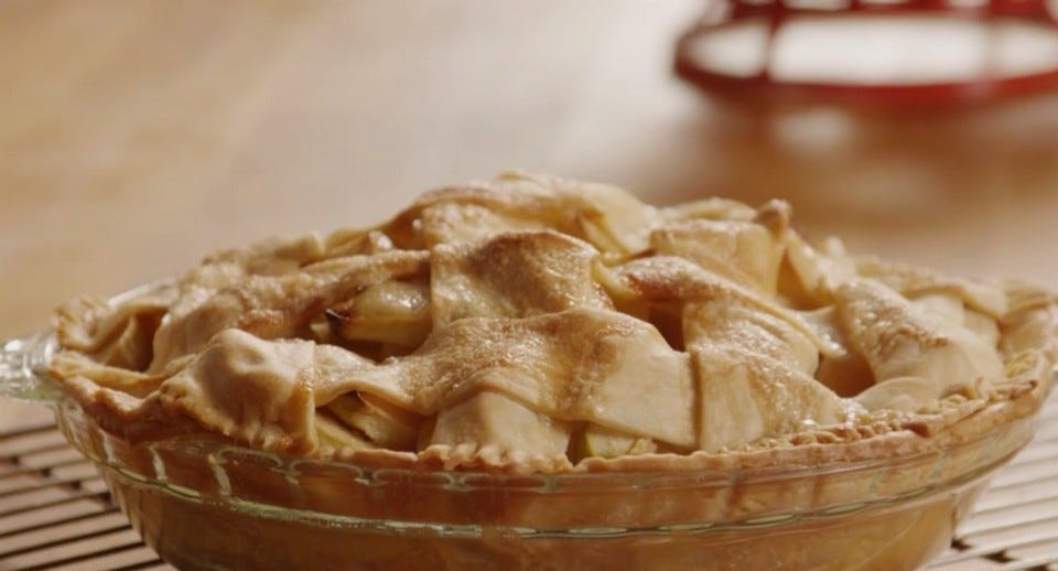delicious fresh apple pie resting on a cooling rack