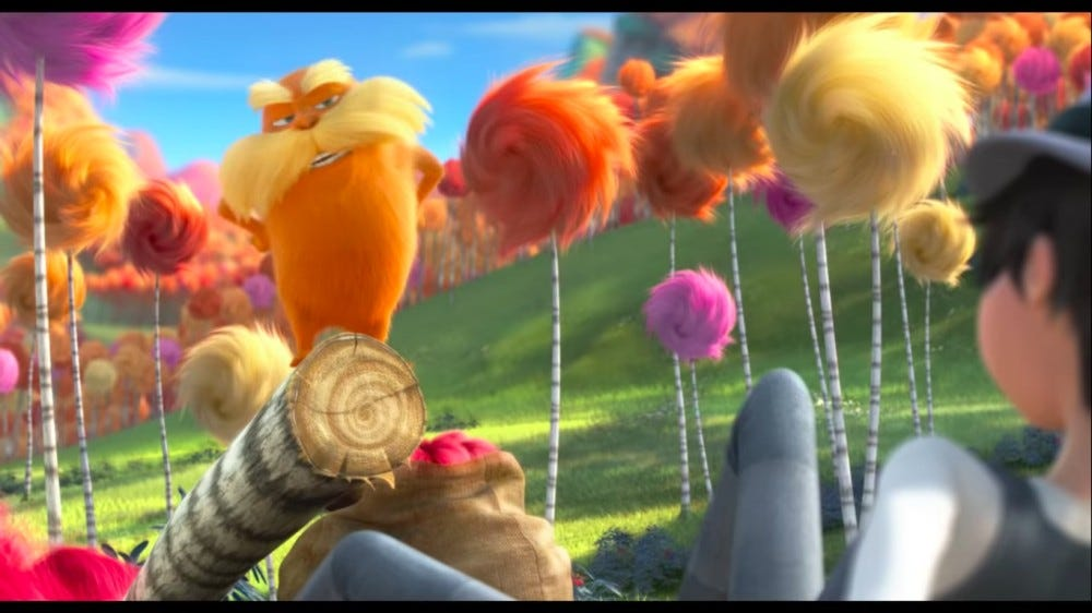 Dr. Suess' character the lorax stands atop a stump.