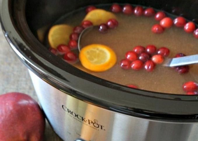 A slow cooker full of cider