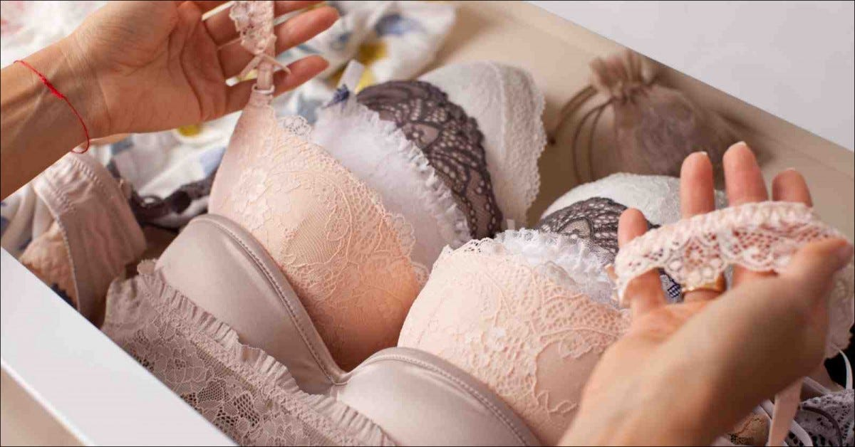 woman choosing bra from drawer full of bras