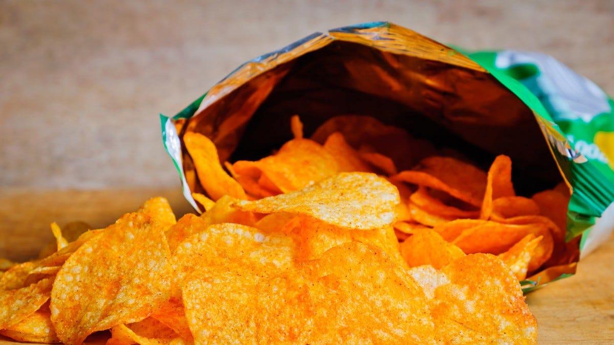 An open bag of BBQ potato chips.