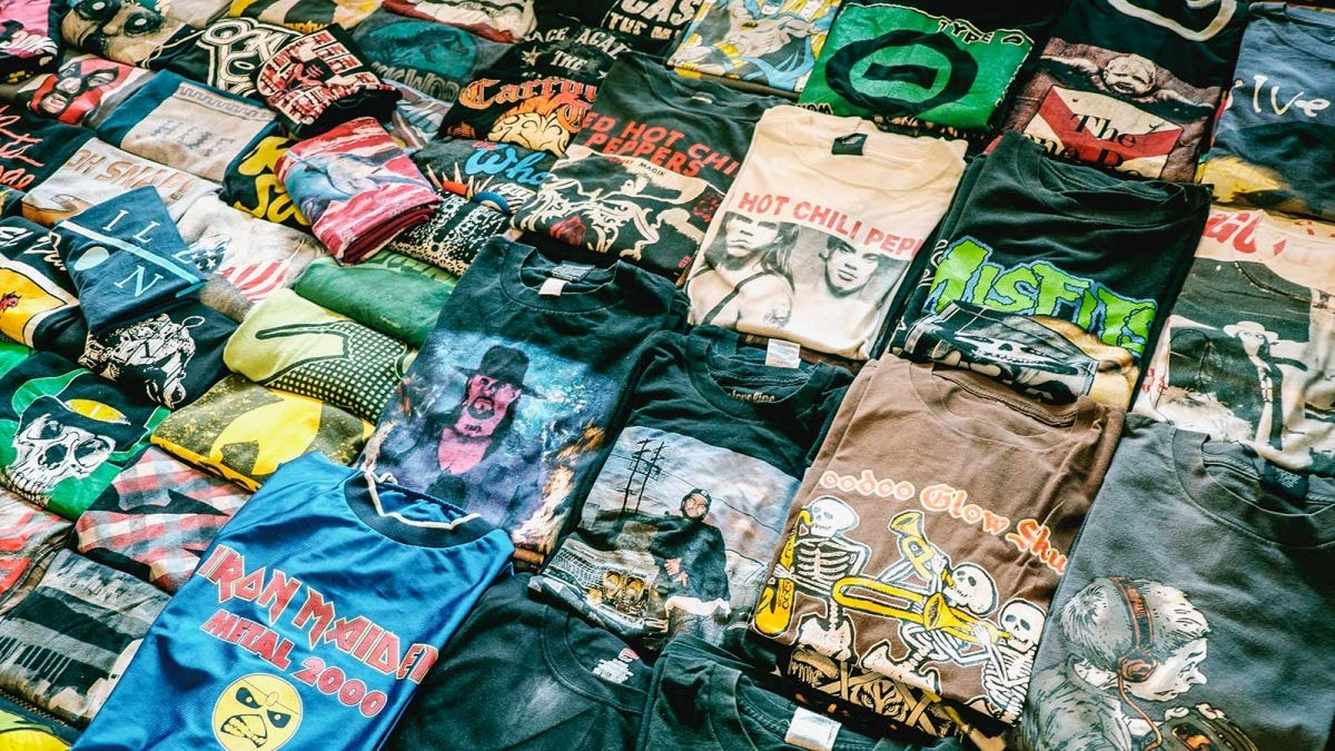 Vintage T-shirts folded and laid out on a table.