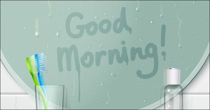 Bathroom misted mirror background with finger drawn text and glassy shelf