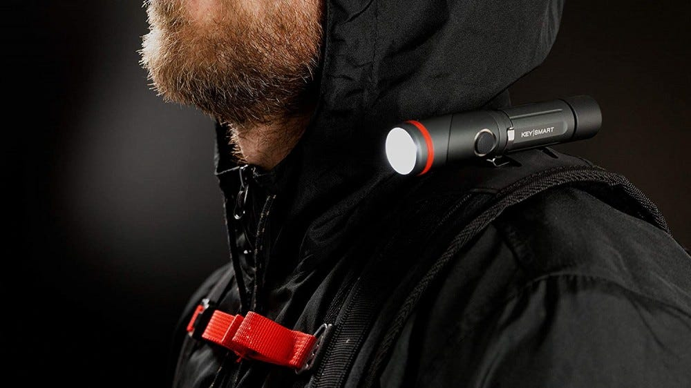 Small flashlight on a man's shoulder.