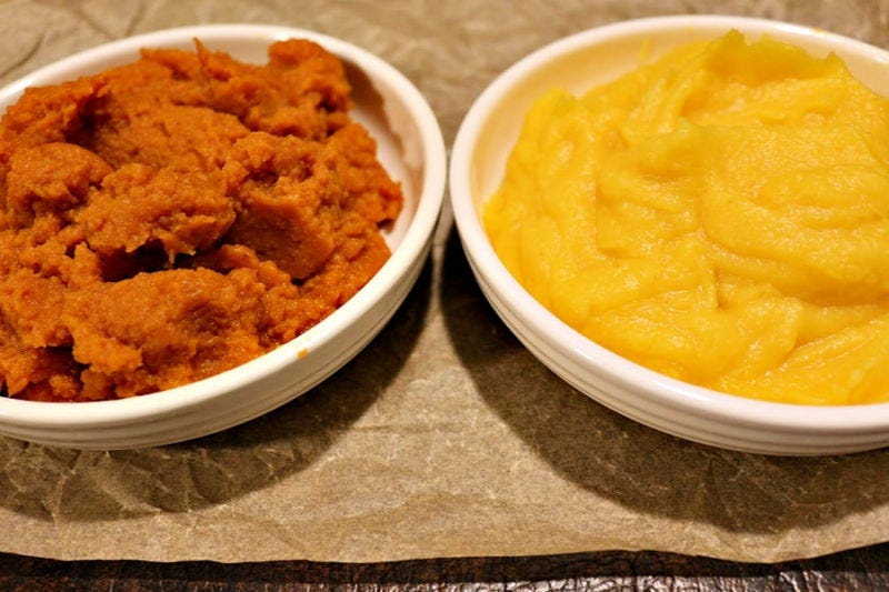 Canned pumpkin in a bowl next to a bowl of fresh roasted and pureed pumpkin.