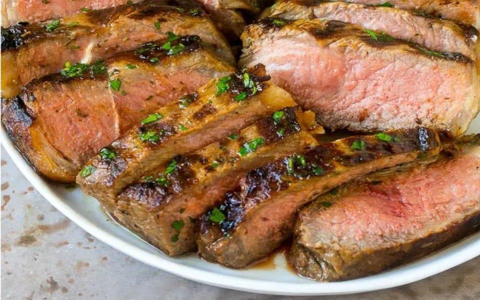 Sliced marinated steak.