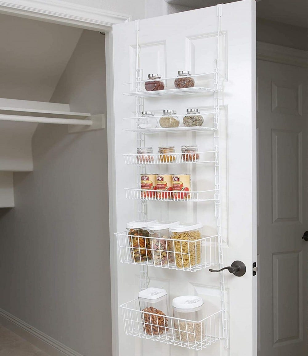 White open closet door with a white wire rack hanging over the door